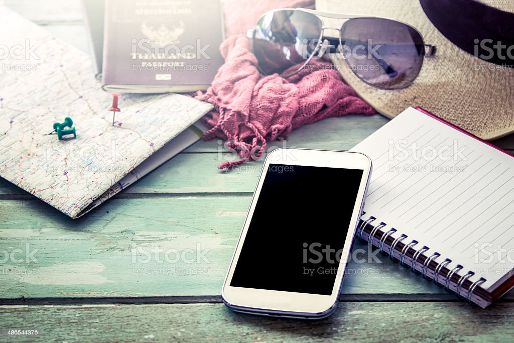 Preparation for travel, cellphone, sunglasses ,passport stock photo