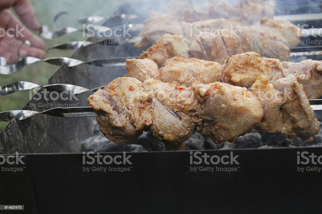 Preparation of a shish kebab royalty-free stock photo
