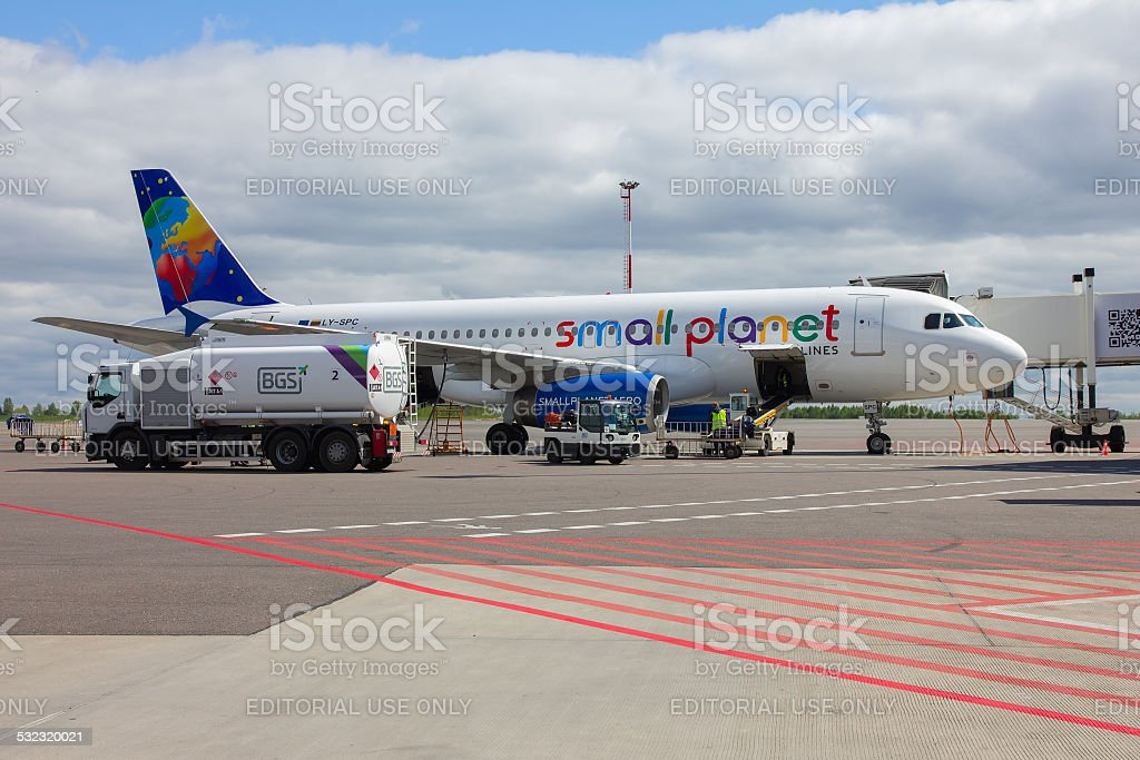 Preparation of aircraft Small Planet Airlines to fly at Vilnius stock photo