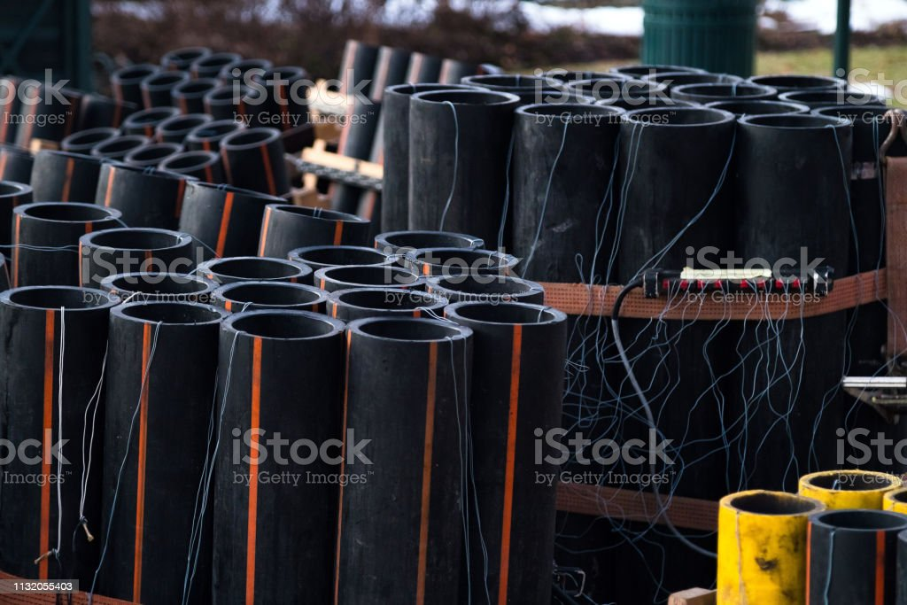 Preparation of big firework show with tubes filled with gunpowder and electric wire on ground. Fireworks festival, entertainment, danger. 4th of July stock photo