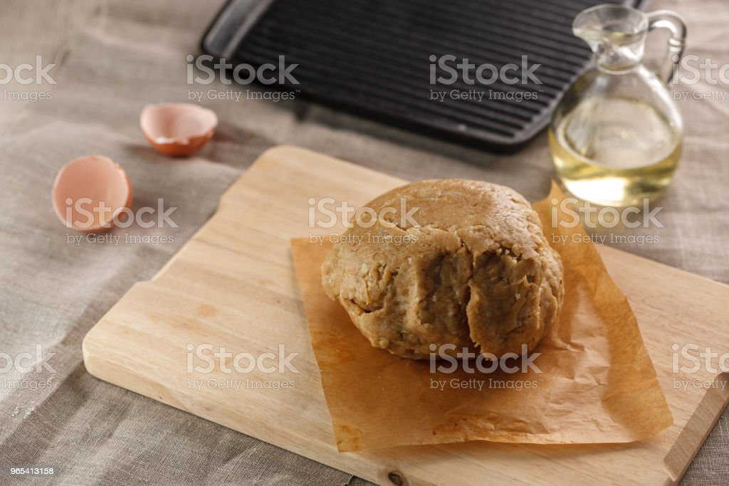 preparation of dough for flat bread. dough ball on the background of the grill pan zbiór zdjęć royalty-free