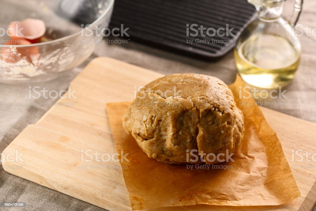 preparation of dough for flat bread. dough ball on the background of the grill pan royalty-free stock photo