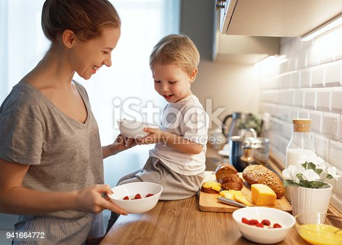 istock preparation of family breakfast. mother and baby son cook porridge in morning 941664772