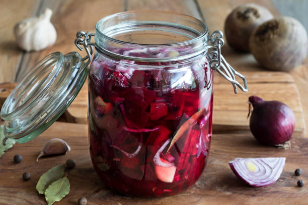 Preparation of fermented beets (beet kvass) in a glass jar stock photo