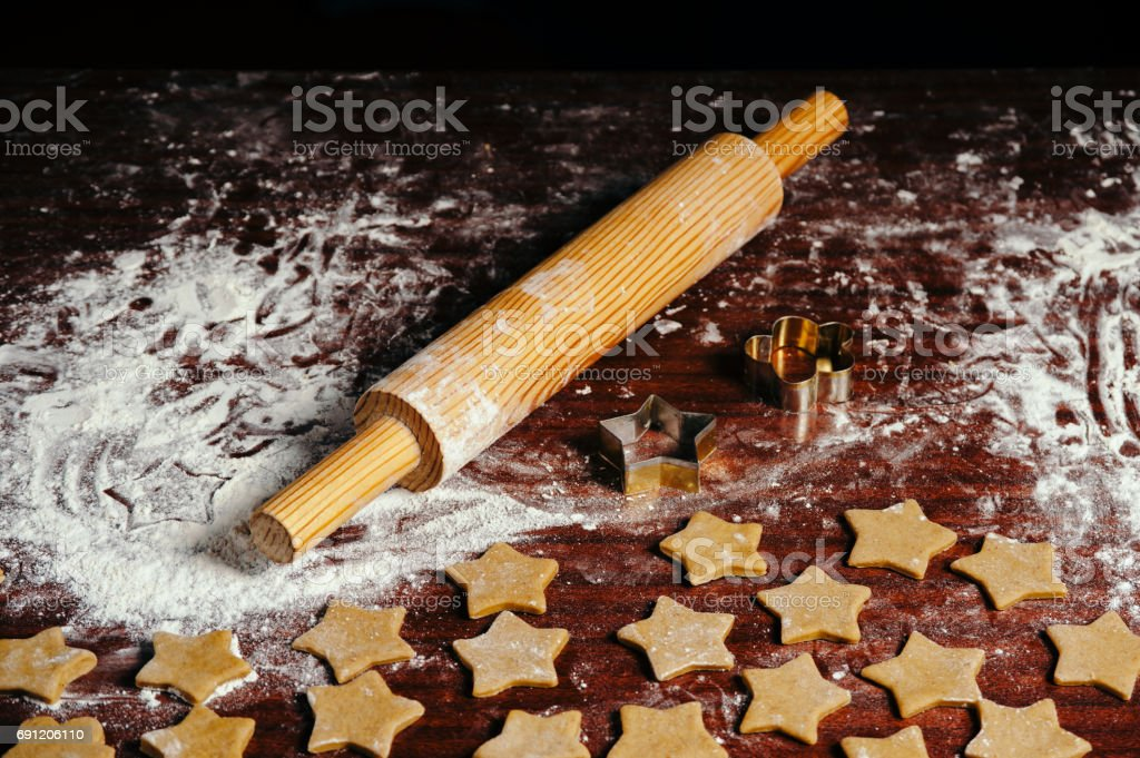 Preparation of ginger biscuits in the form of asterisks. stock photo