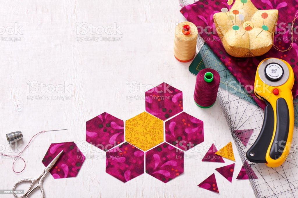 Preparation of hexagon pieces of fabric for sewing a quilt Grandmother's Flower Garden stock photo