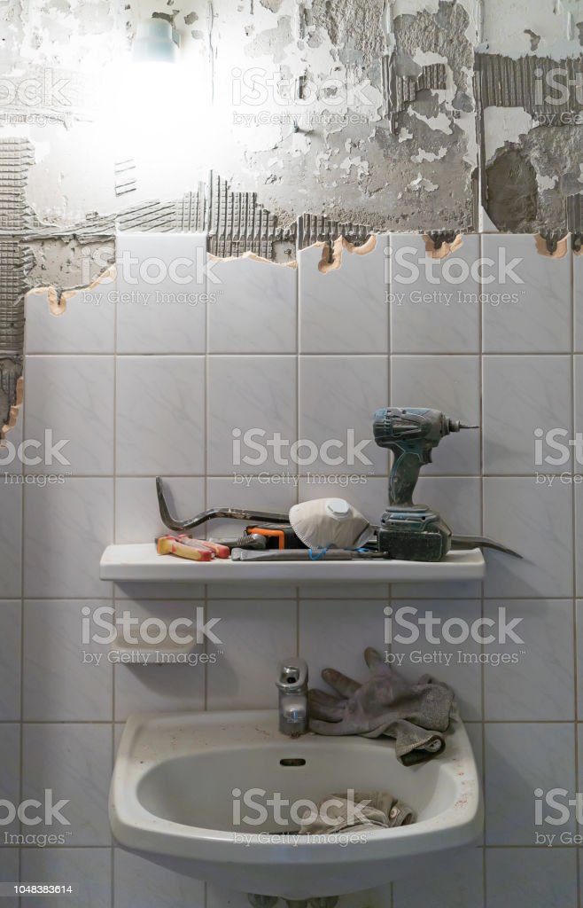 Preparation of repair the bathroom. Removing old tiles.