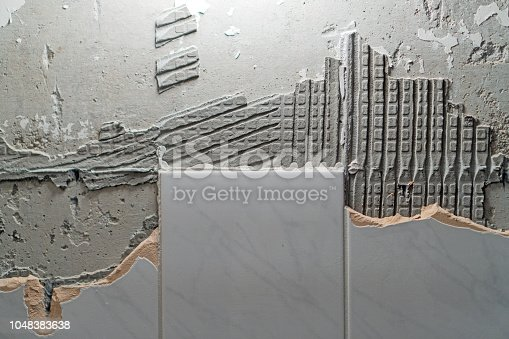 istock Preparation of repair the bathroom. Removing old tiles. 1048383638