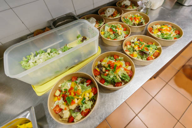 Preparation of salads to take away stock photo