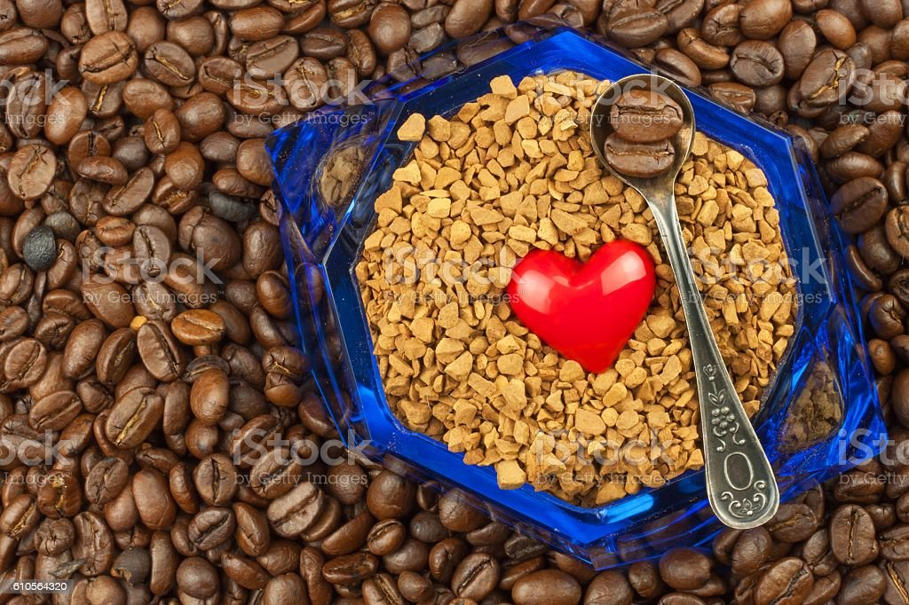 Coffee beans and instant coffee. Granules of instant coffee...