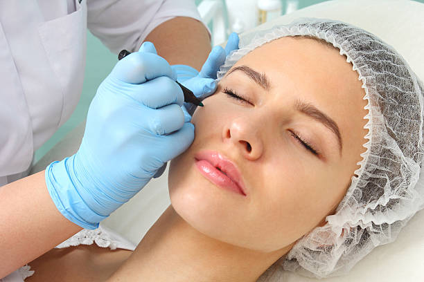 preparation of the patient's face to a cosmetic procedure. - eyelid stock pictures, royalty-free photos & images