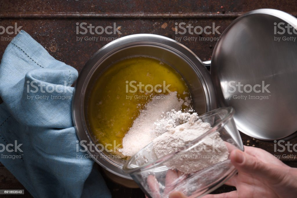 Preparation of veloute sauce on the wooden table  top view stock photo