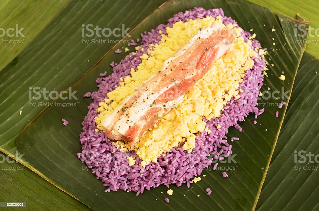 Preparation of Vietnamese pork rice cake wrapped in banana leave stock photo