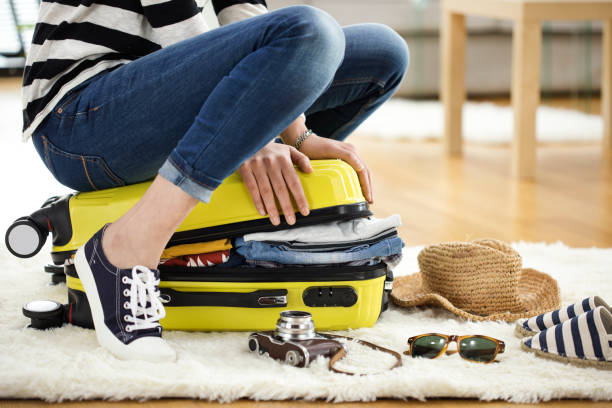 preparation travel suitcase at home - luggage stock photos and pictures