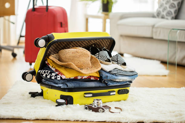 Preparation travel suitcase at home stock photo