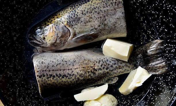 Preparation trout in white wine stock photo