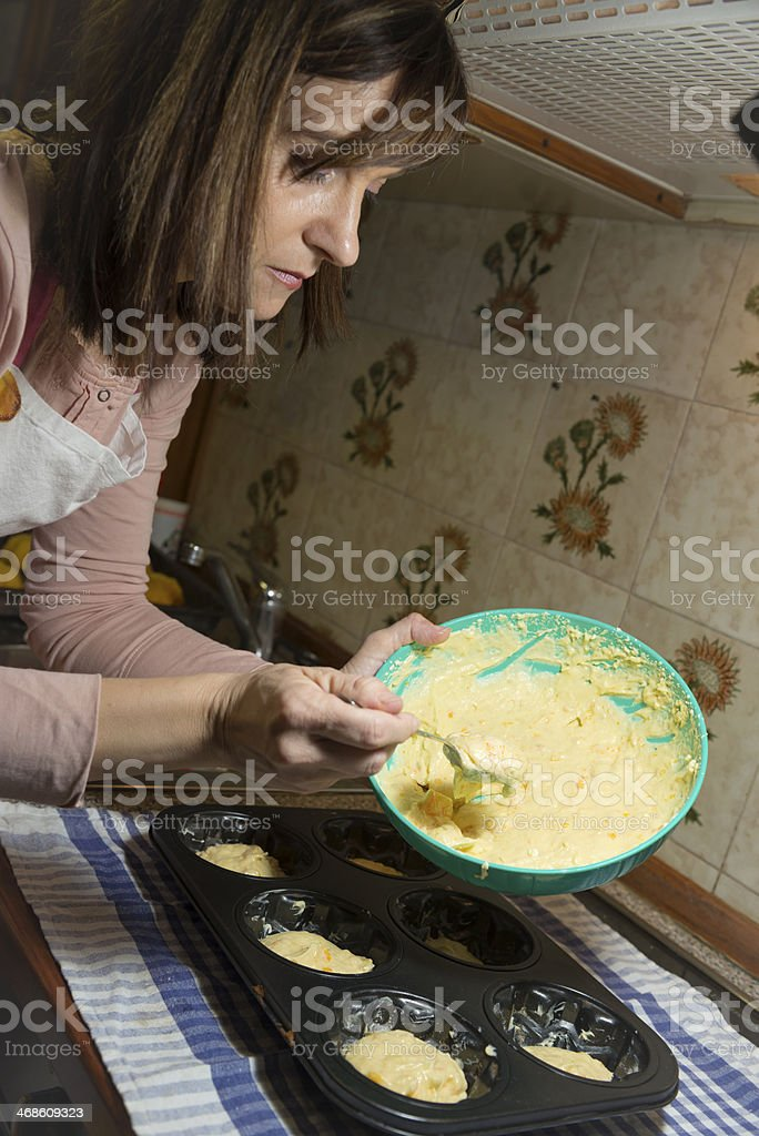 Preparations for Baking at Home, Filling Models with Dough Dough royalty-free stock photo