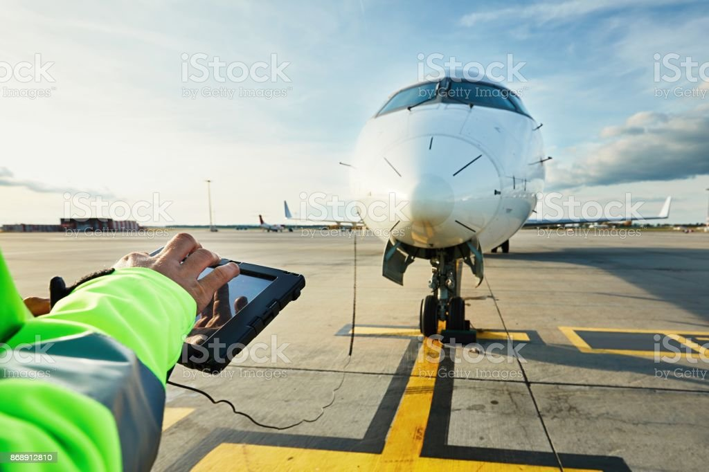 Preparations of passenger airplane at the airport stock photo