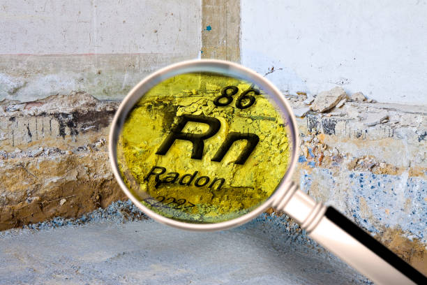 Preparatory stage for the construction of a ventilated crawl space in an old brick building - Searching gas radon concept image seen through a magnifying glass. stock photo