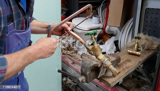 Preparatory work to install an outdoor faucet. Plumber during the preparation work to install an outdoor faucet.