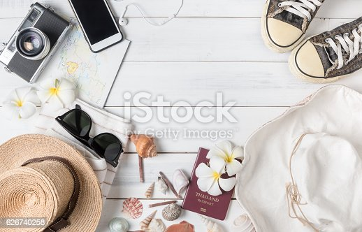 istock prepare accessories and travel items on white wooden background 626740258