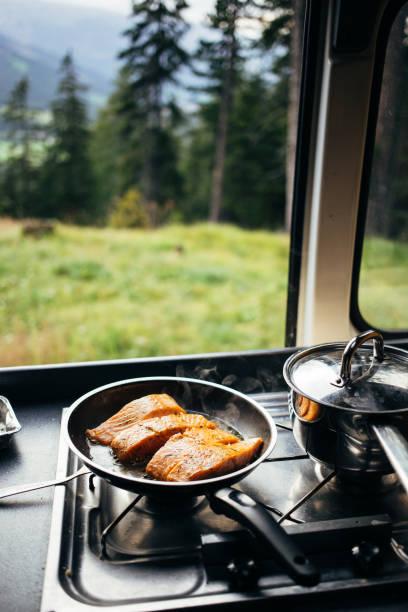 Prepare food in camper van kitchen on the road stock photo