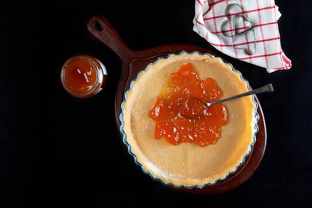 prepare homemade cake with fruit jam stock photo