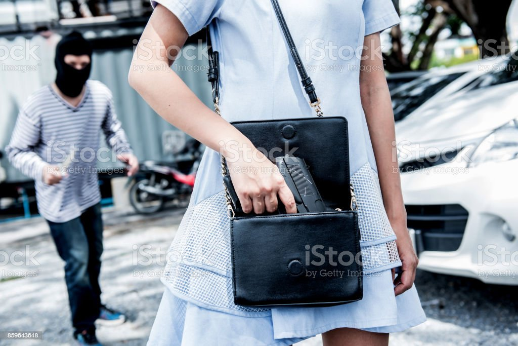 Prepare the gun for protect from the thief stock photo