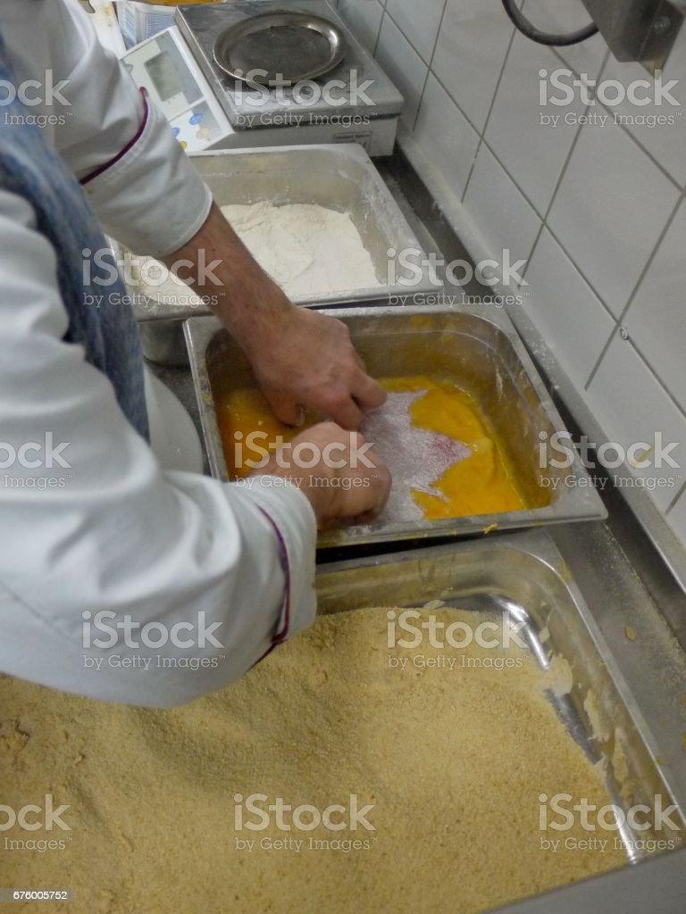Prepare 'Wiener Schnitzel' stock photo