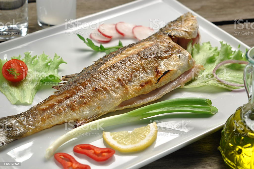 Prepared dinner consisting of grilled Seabass and vegetables royalty-free stock photo