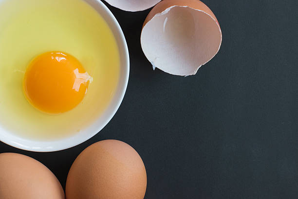 Prepared egg in white bowl Prepared egg in white bowl egg white stock pictures, royalty-free photos & images