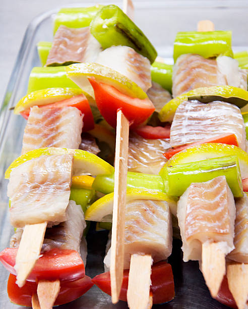 prepared fish slices on  the grill skewers stock photo