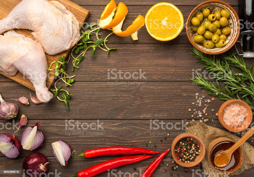 Prepared for cooking chicken legs. Flat lay stock photo