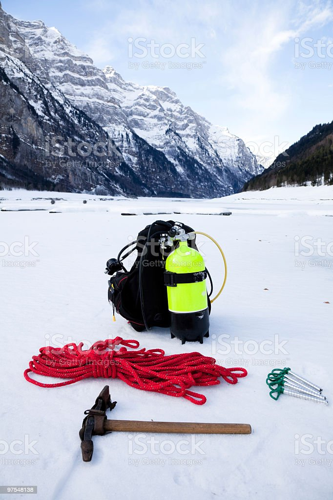Prepared for save Ice-Diving with some ice climbing equipment royalty-free stock photo