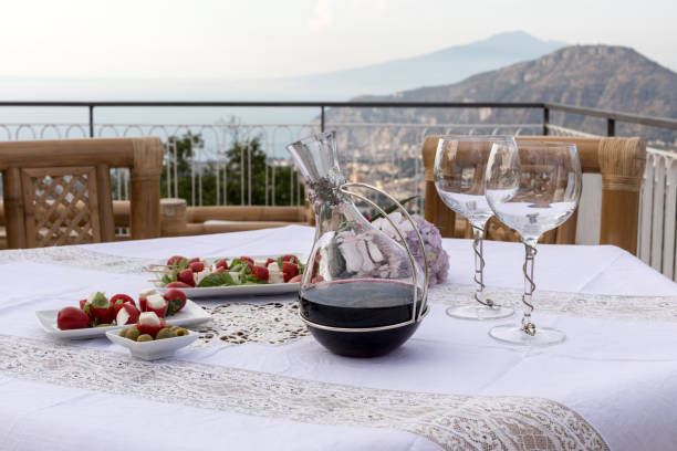 Prepared for supper table on the terrace overlooking the Bay of Naples and Vesuvius. Sorrento. Italy stock photo