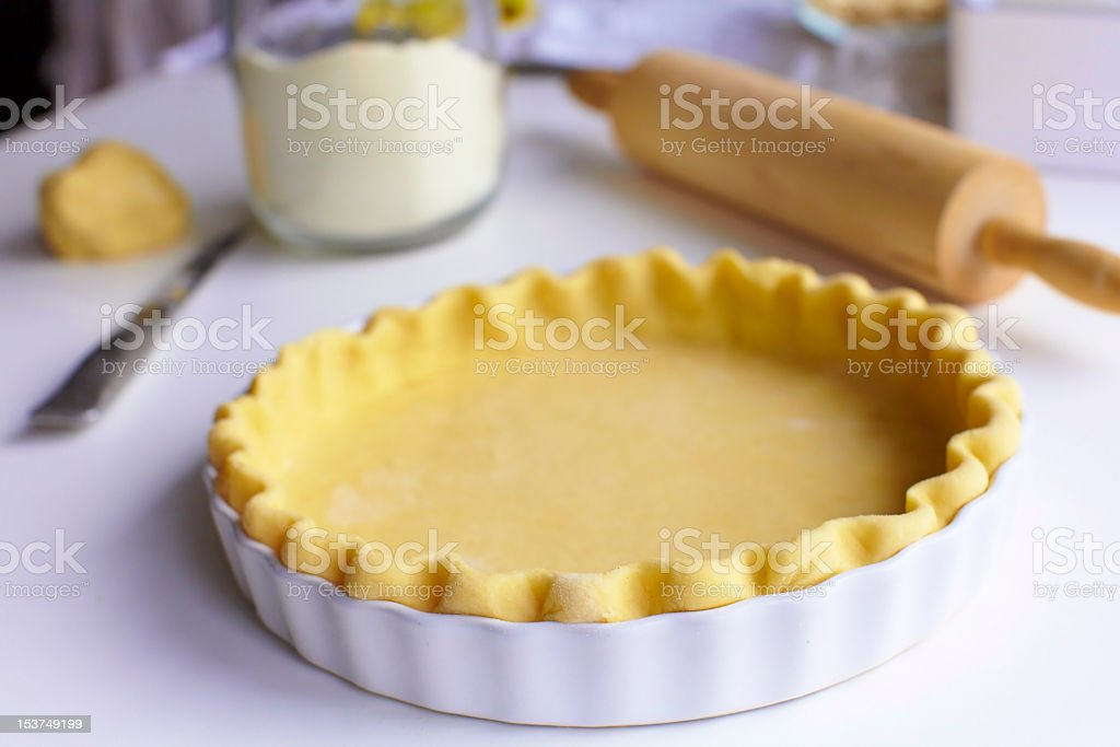 Prepared pie pastry with bakery materials in the background stock photo
