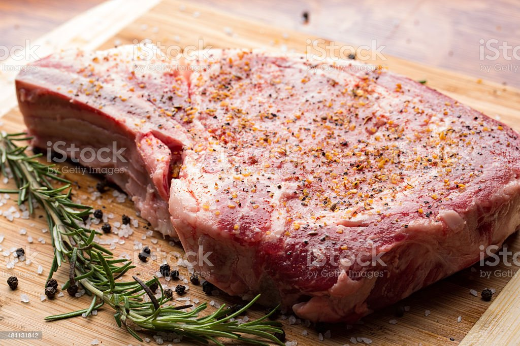 Prepared raw steak, ready to be cooked stock photo