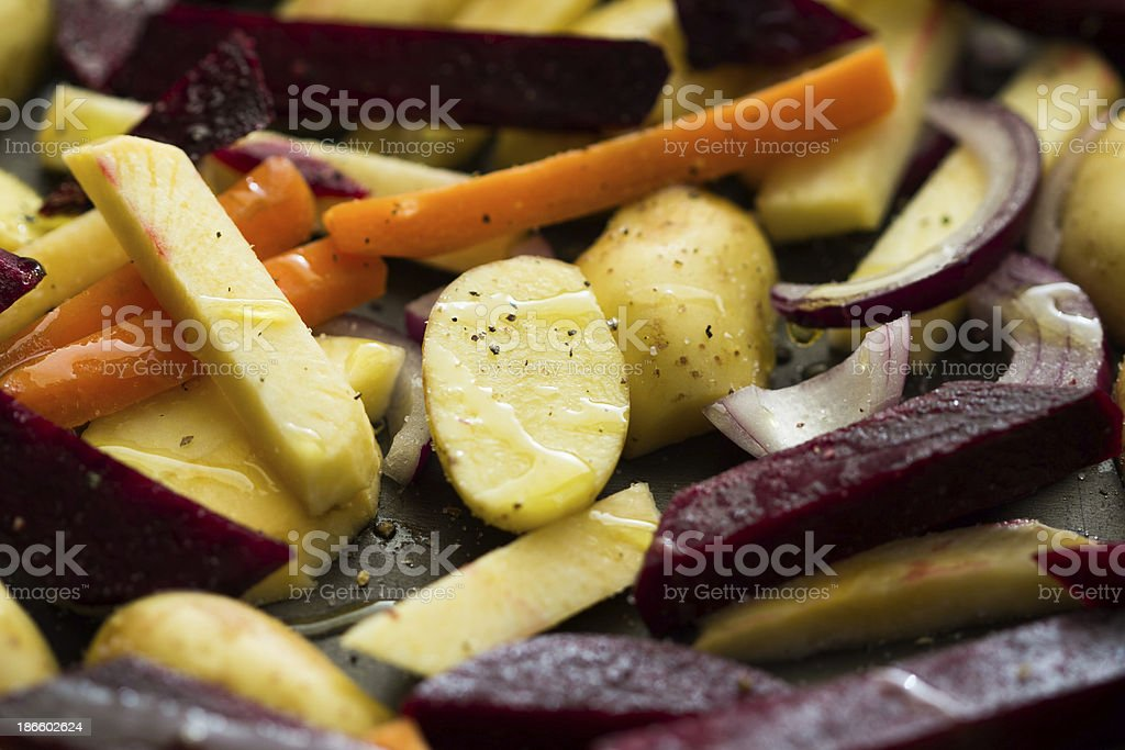 Prepared roots for baking dish, carrots, potatoes, beets, radish stock photo