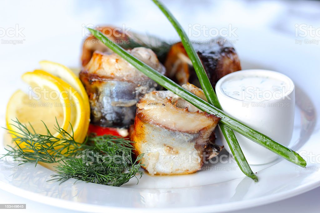 Prepared sea fish portions with greens and vegatables royalty-free stock photo