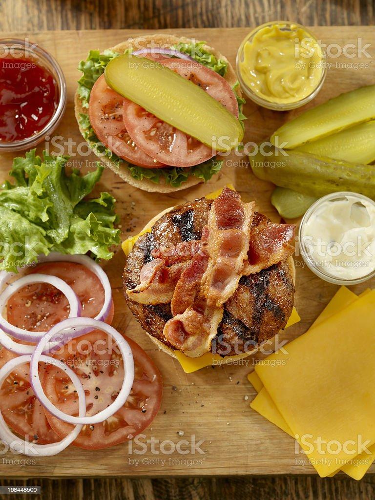 Preparing a Bacon Cheeseburger royalty-free stock photo