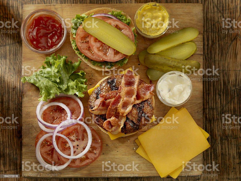 Preparing a Bacon Cheeseburger stock photo