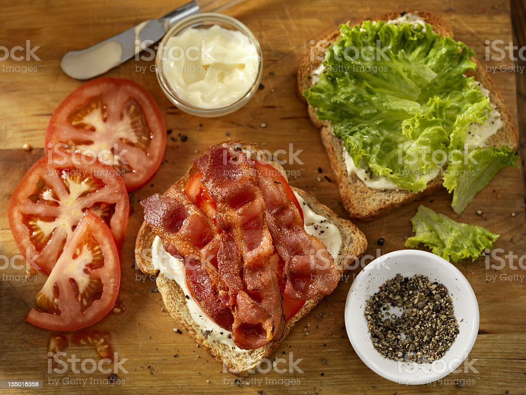 Preparing a BLT Sandwich stock photo