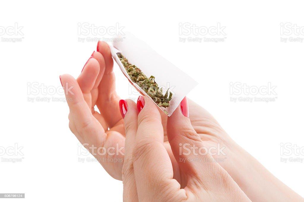Preparing a cannabis joint. stock photo