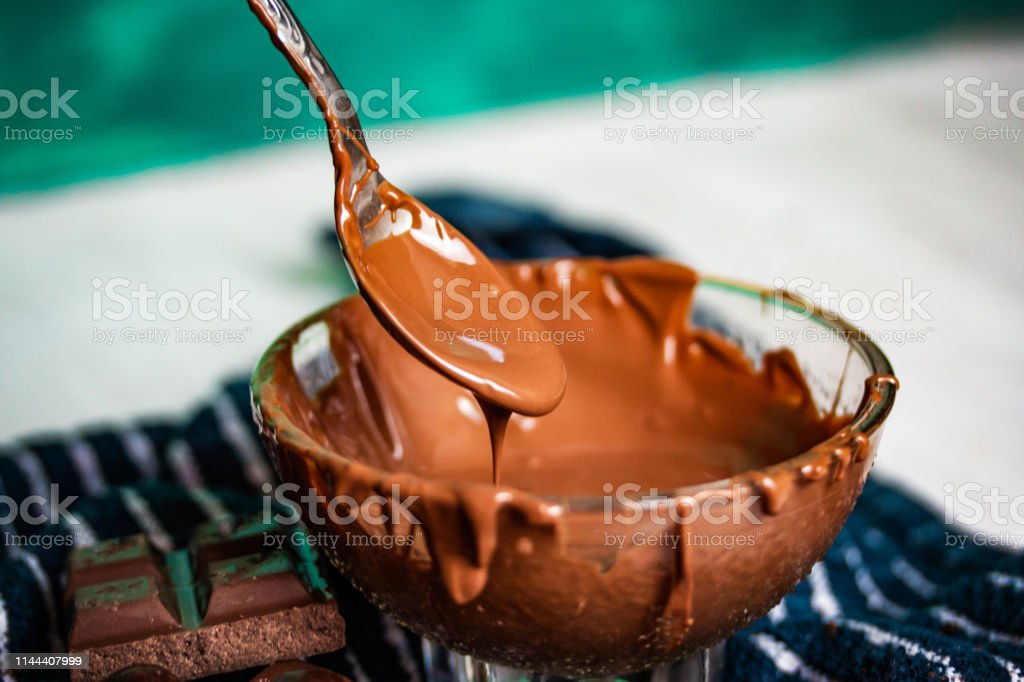 Preparing a chocolate dessert with melted chocolate