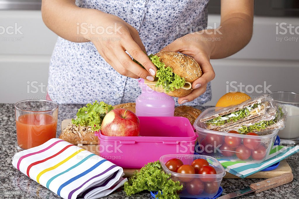 Preparing a delicious sandwich stock photo