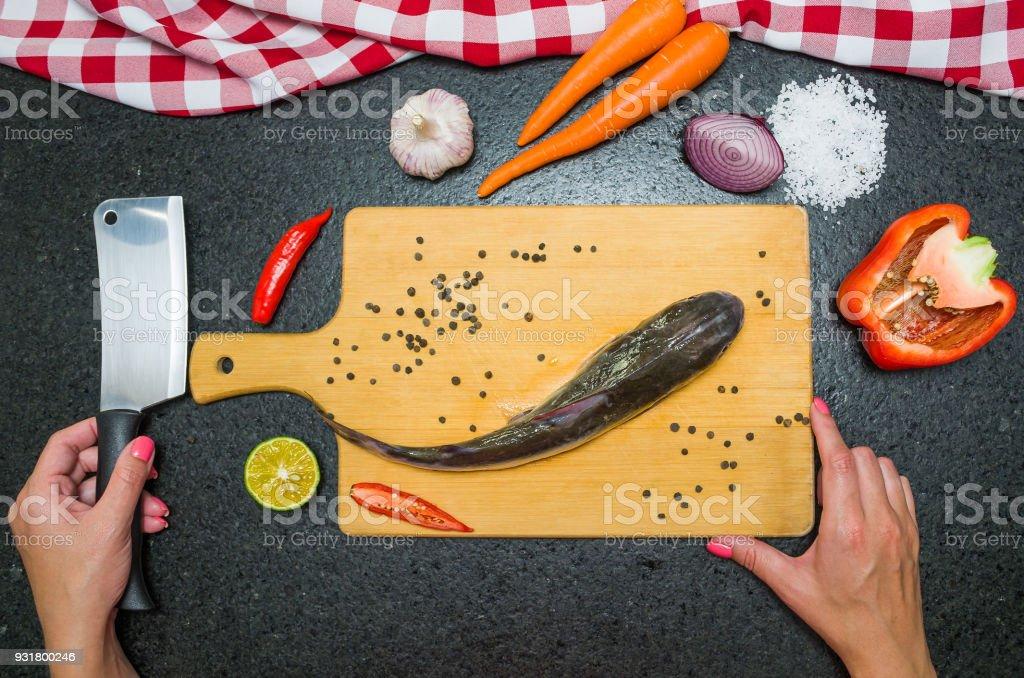 Preparing a gastronomic fish dish catfish. stock photo