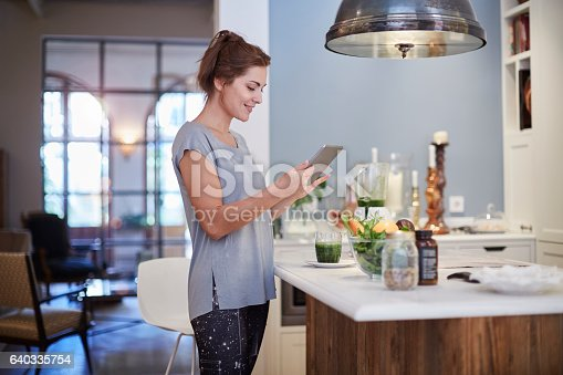 istock Preparing a green smoothie at home. 640335754