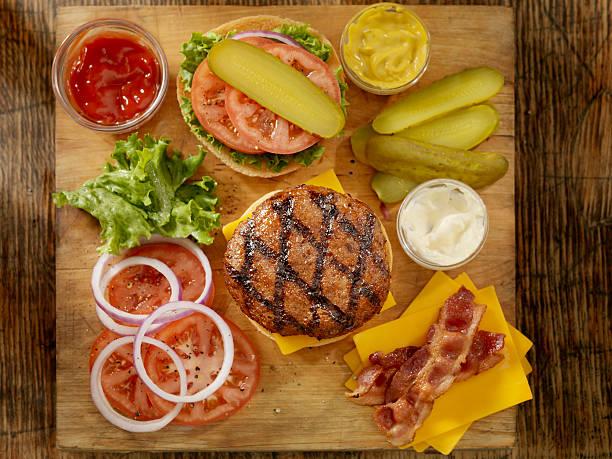 Preparing a Hamburger  bacon cheeseburger stock pictures, royalty-free photos & images