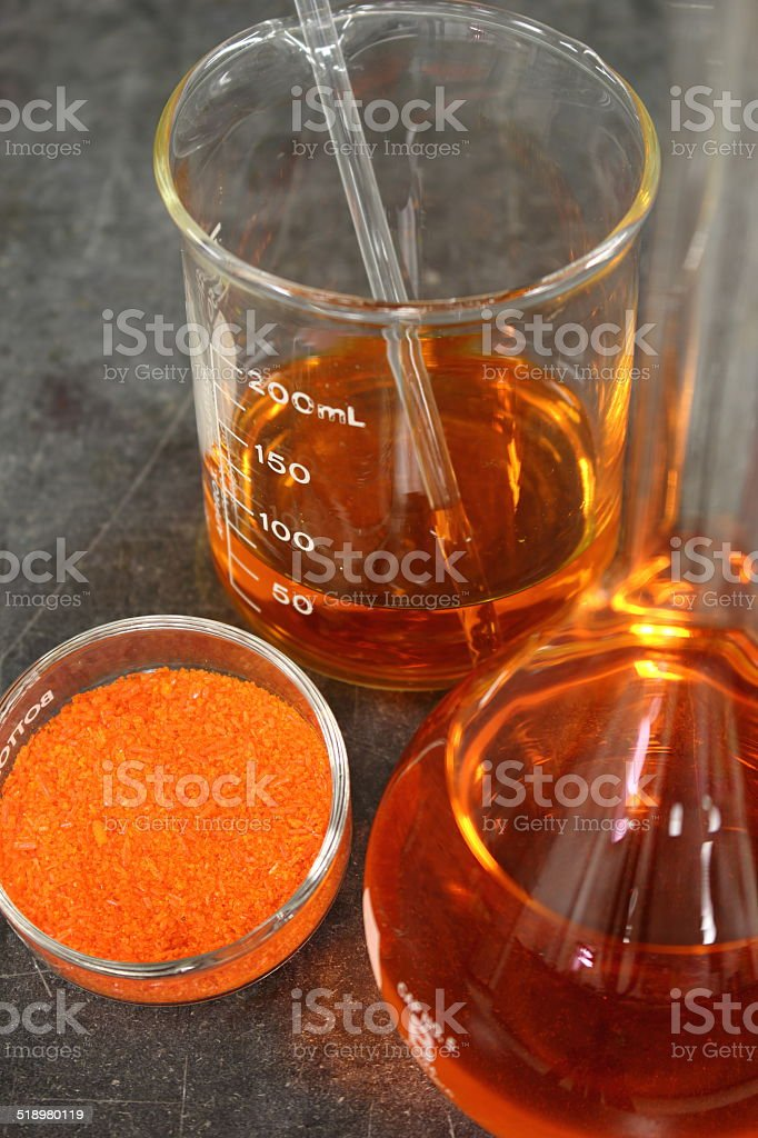 Preparing a solution from the salt of sodium dichromate stock photo