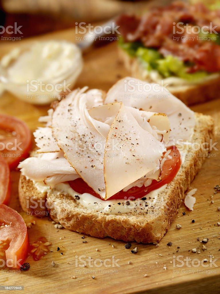 Preparing a Turkey BLT Sandwich royalty-free stock photo
